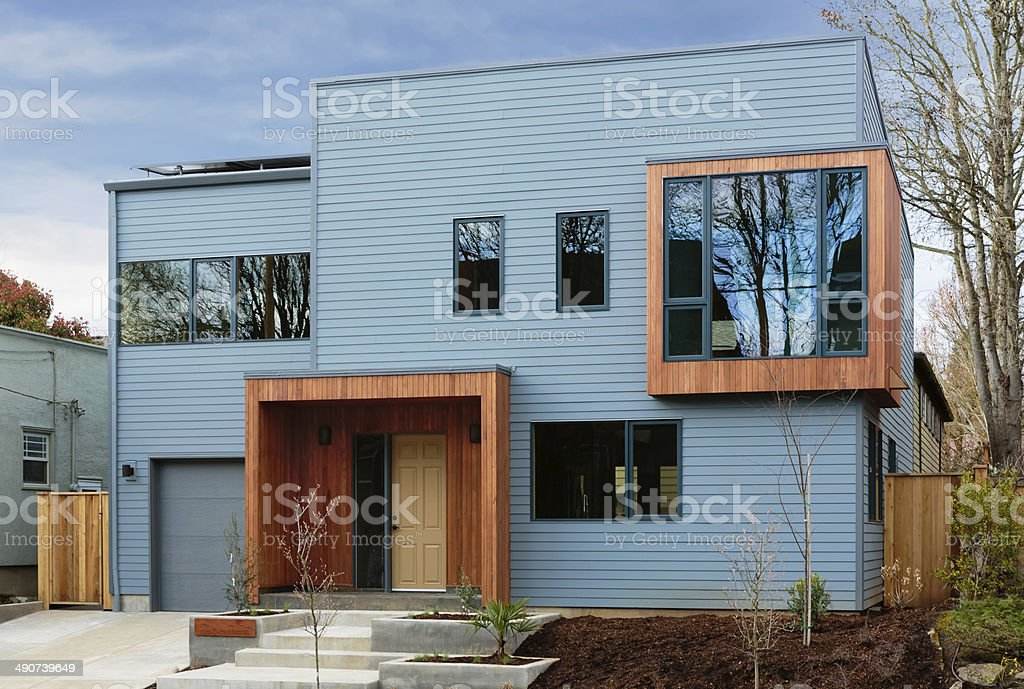 Horizonal shot of a modern, upscale home with blue sky stock photo