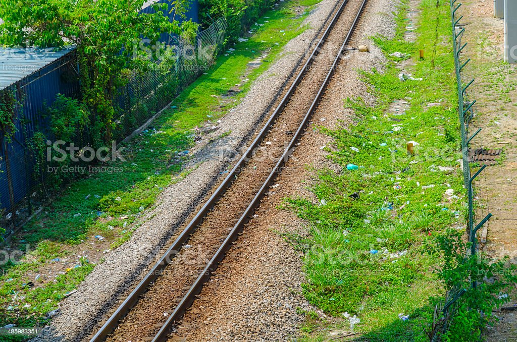 Horizontal closeup of railway lines in sunlight royalty-free stock photo