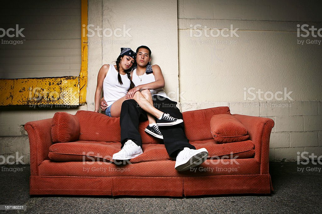 Horizontal Couple Sitting on Couch Portrait royalty-free stock photo