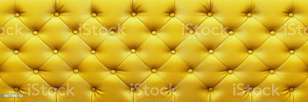 horizontal elegant yellow leather texture with buttons for background and design stock photo