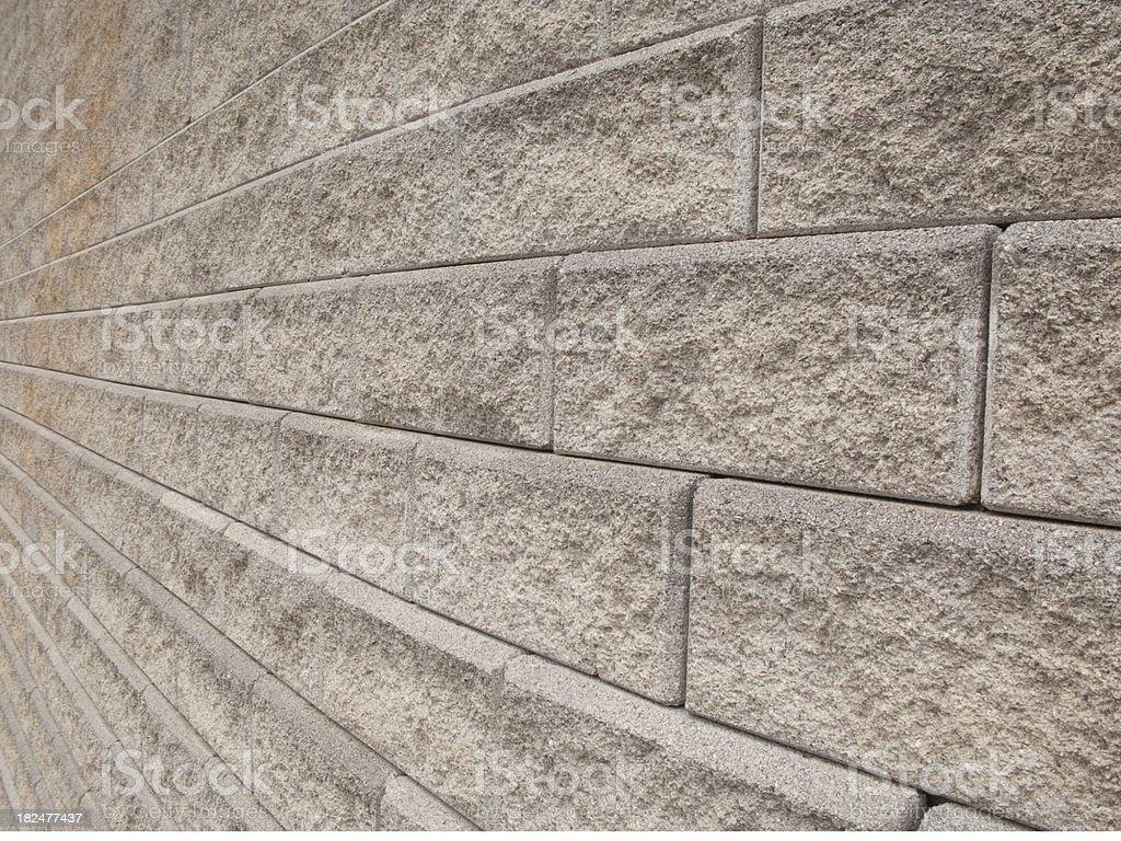 Horizontal image of a huge brick block retaining wall. royalty-free stock photo