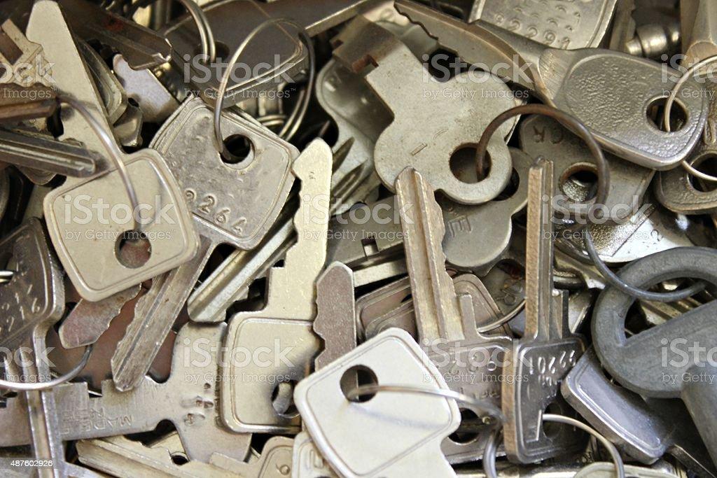 Horizontal image of lots of steel keys stock photo