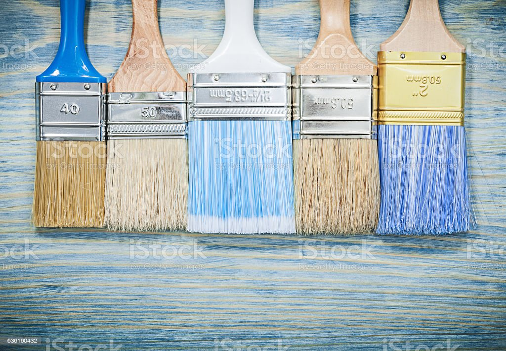 Horizontal image of paintbrushes on wooden board construction co stock photo