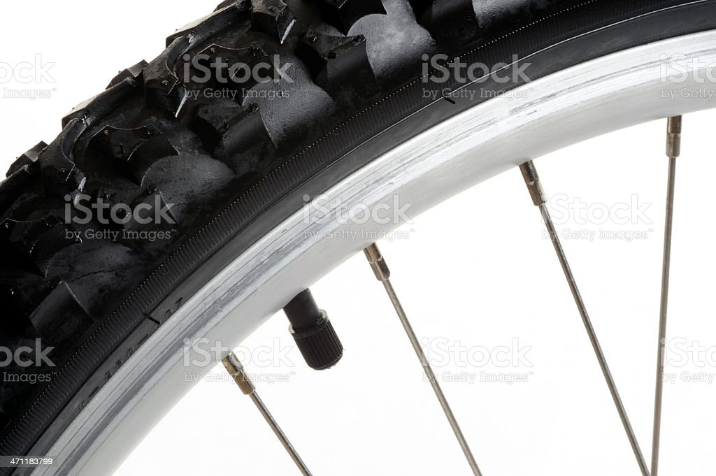 Horizontal macro of a mountain bike tire treads and stem royalty-free stock photo