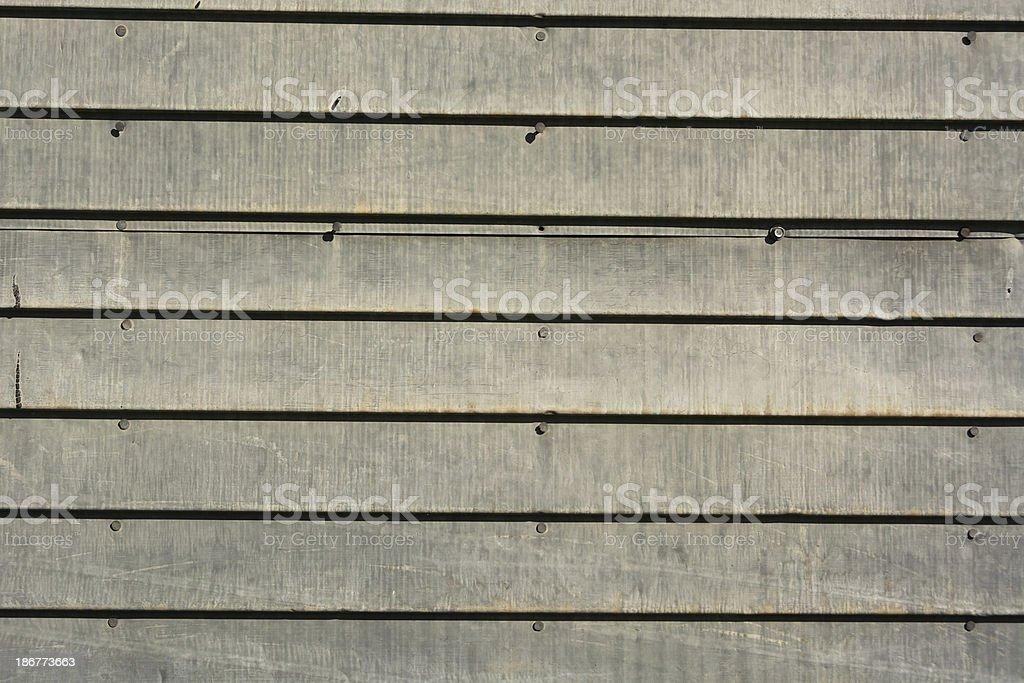 Horizontal of weathered metal siding with writing. stock photo