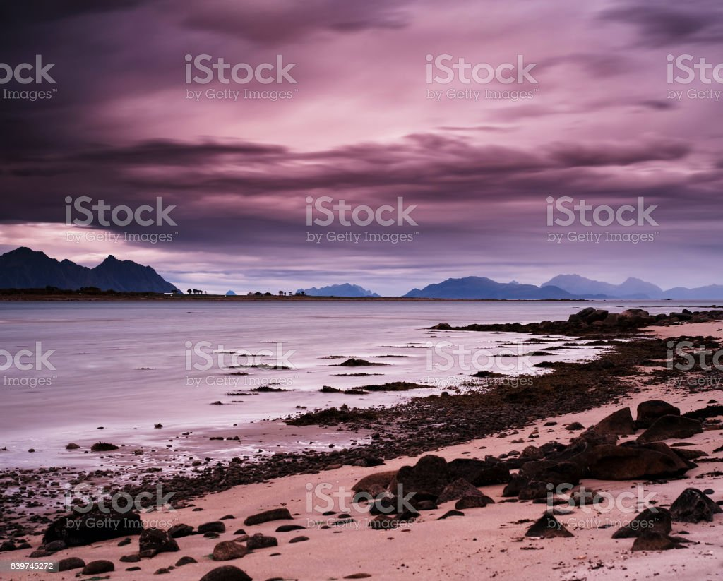 Horizontal pink vibrant evening at Norway fjords beach landscape stock photo