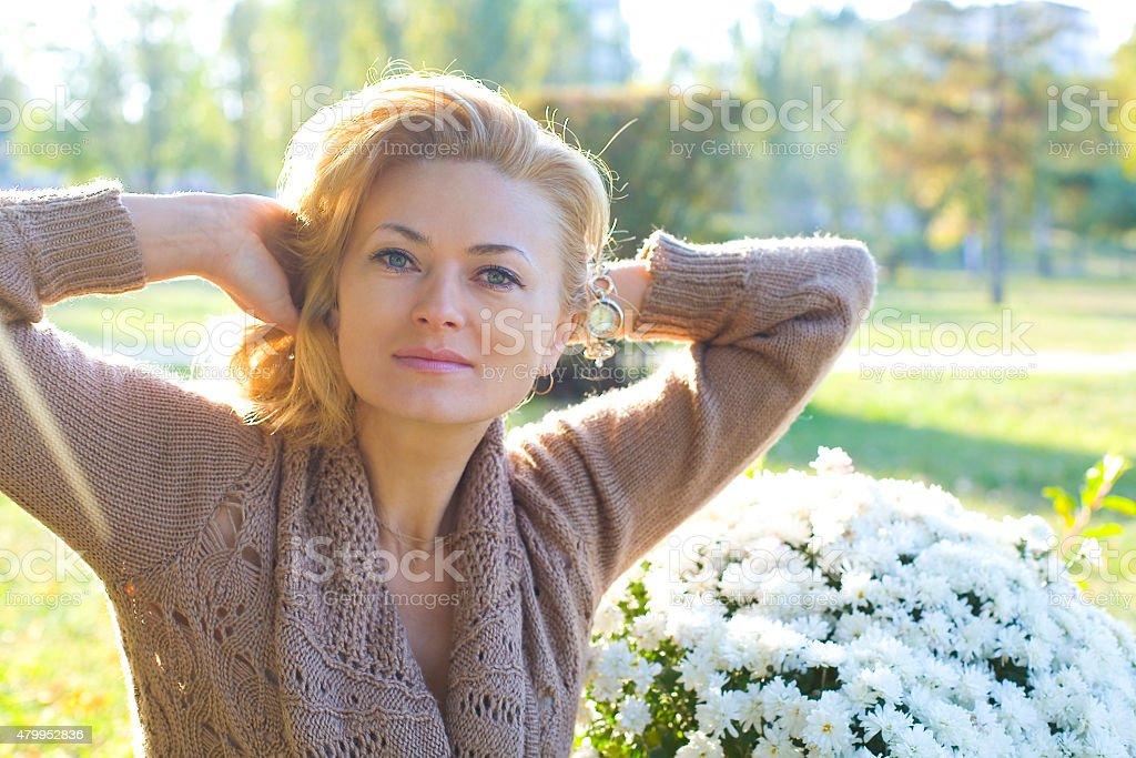 Horizontal portrait of a beautiful woman 35 years outdoors stock photo