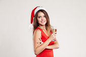 Horizontal portrait of christmas girl with wineglass on white background