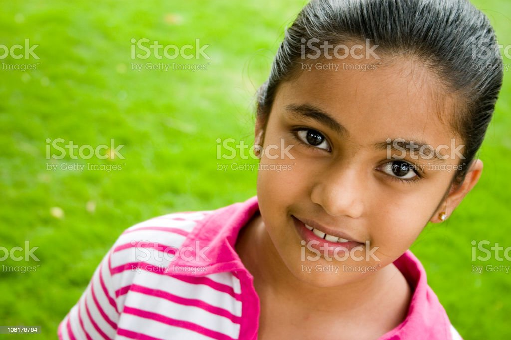 Horizontal Portrait of One Cheerful Cute Small Indian Girl Kid stock photo
