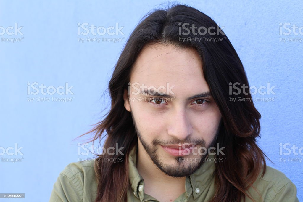 Horizontal portrait of young man with long hair stock photo
