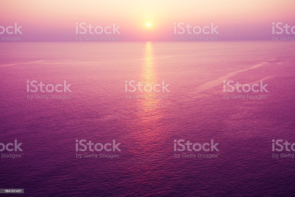 Horizontal romantic purple sunset over water stock photo