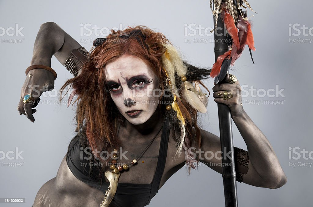 Horizontal Shamanic Necromancer on grey background stock photo