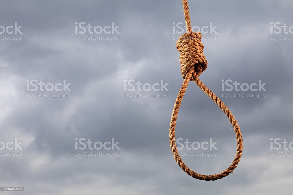 Horizontal shot of a noose and stormy sky. stock photo