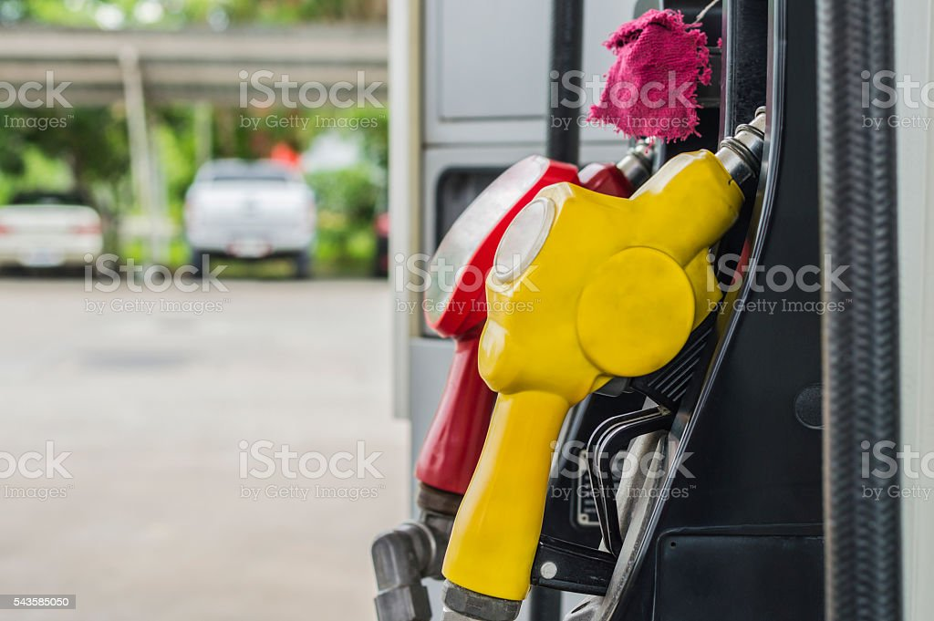 Horizontal shot of some fuel pumps at a gas station. stock photo