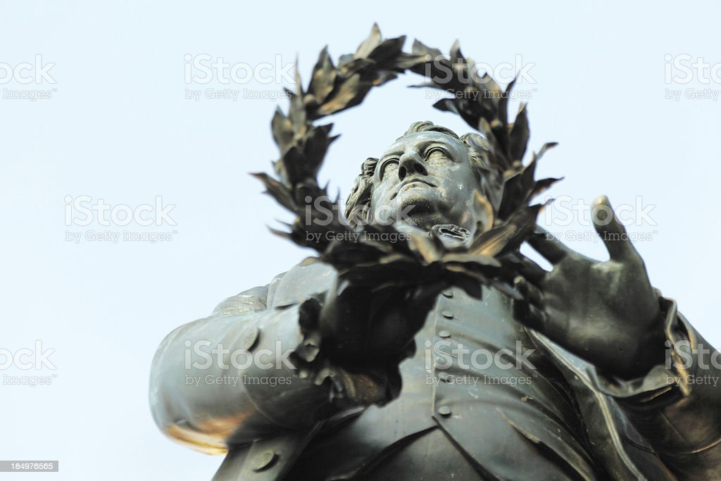 horizontal statue portrait of Goethe in Weimar through laurel wr stock photo