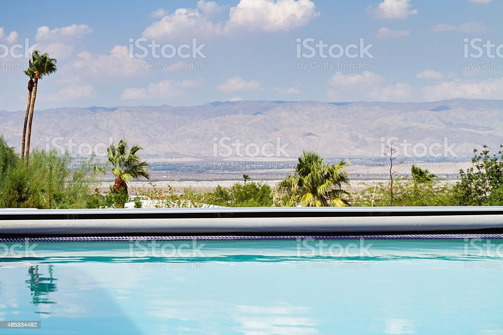 Horizontal Swimming pool with a view of the mountains stock photo