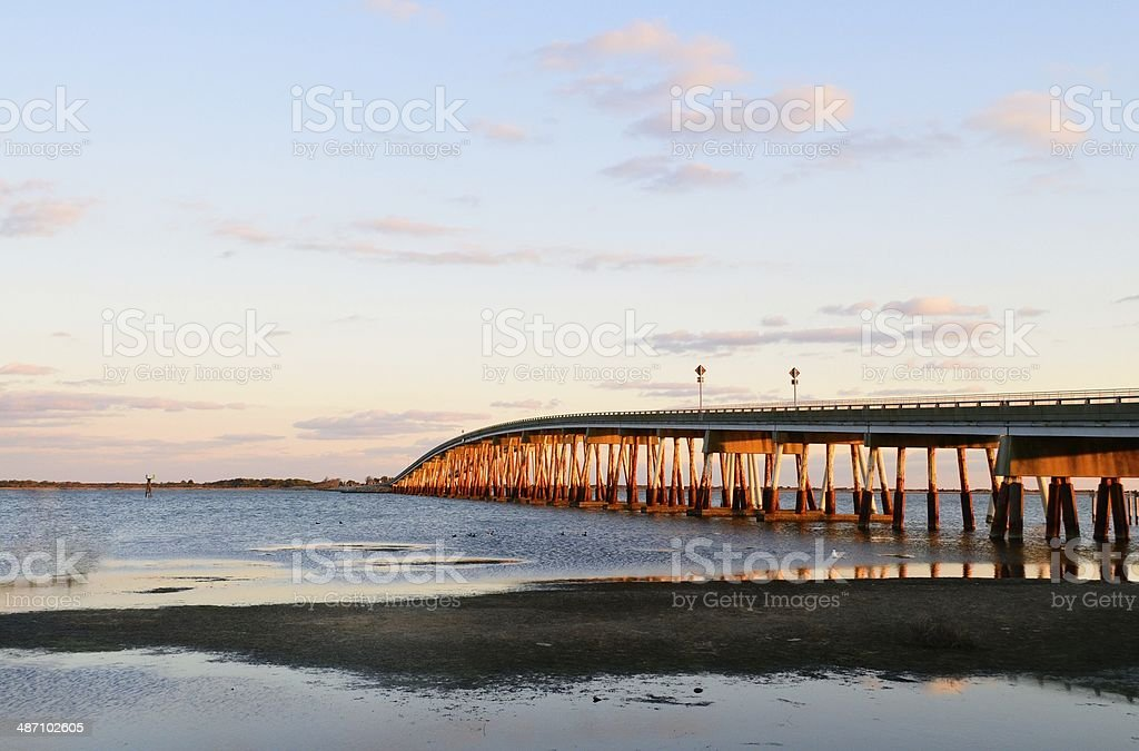 Horizontal Verazano Bridge To Assateagur Island At Sunset stock photo