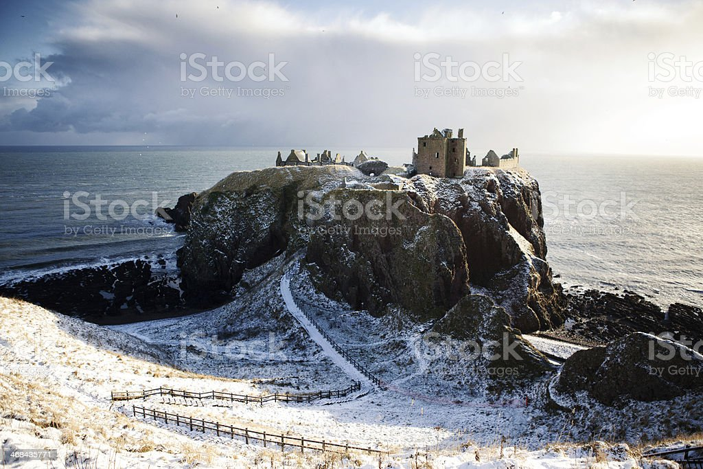 Horizontal View in Snow - Dunnottar Castle, Stonehaven, Scotland UK stock photo
