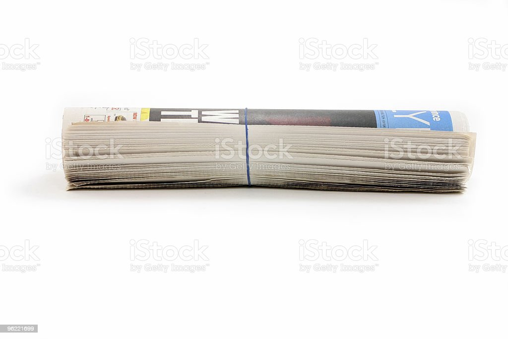 Horizontal view of rolled newspaper secured with an elastic  royalty-free stock photo