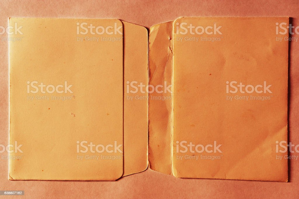 Horizontal vintage double page orange empty floppy case backgrou stock photo
