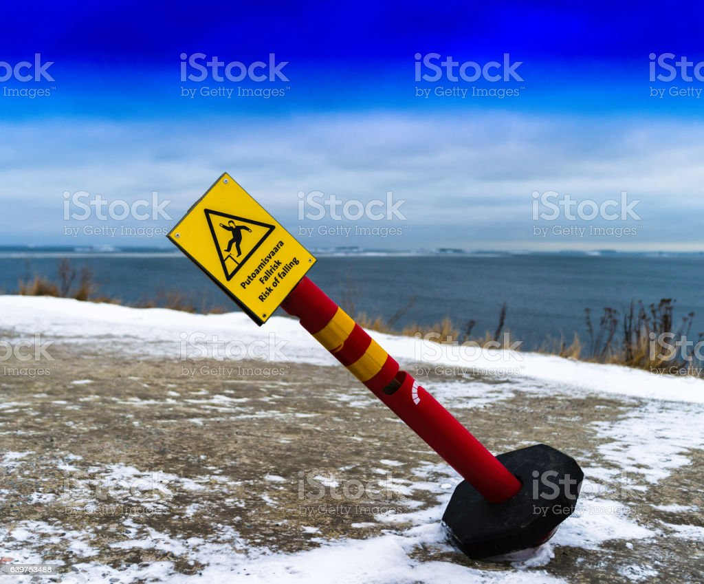 Horizontal vivid tilted risk of falling sign background backdrop stock photo