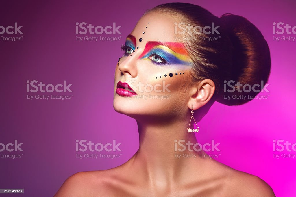 Horizotnal portrait of attractive woman with multicolor make up stock photo
