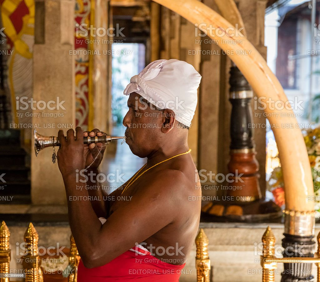 Horn player at Temple of the Tooth, Kandy, Sri Lanka stock photo