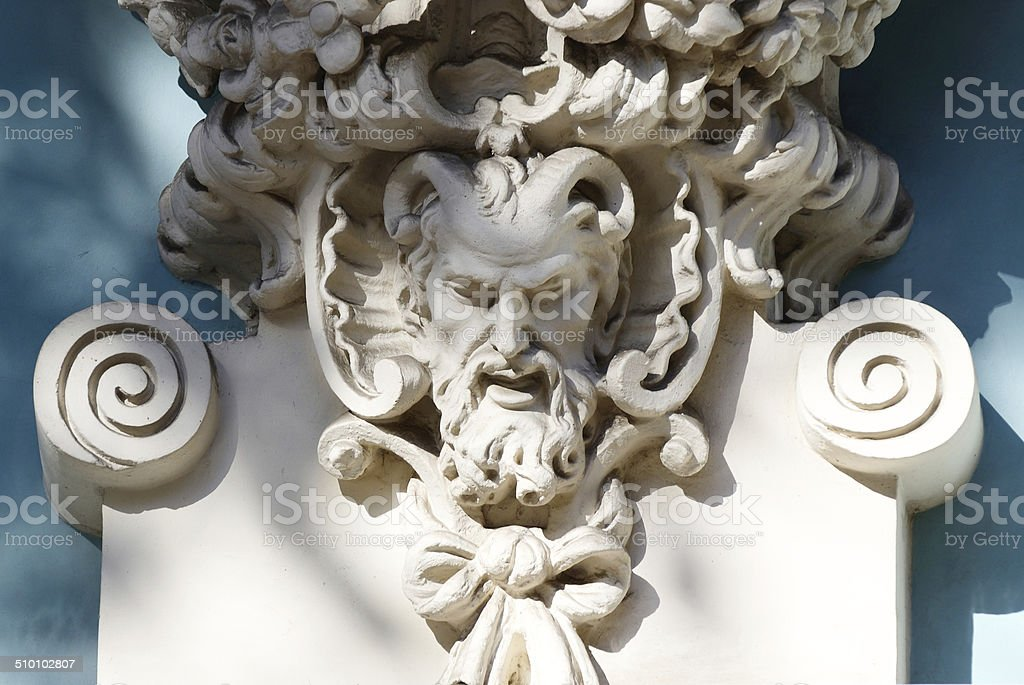 Horned head of greek mythic god Satyr,old house decoration stock photo