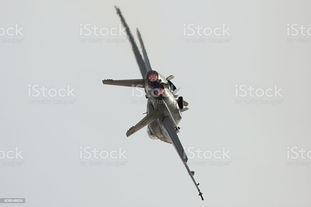 F-18 Hornet in a roll at takeoff with afterburners on stock photo