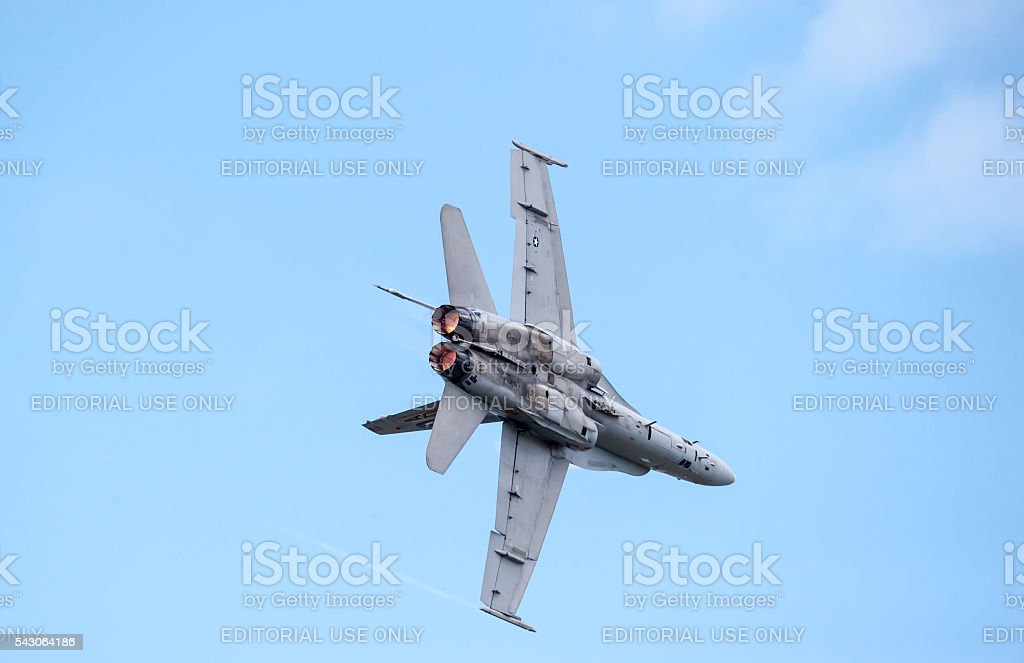 F/A-18 Hornet soaring across the sky stock photo