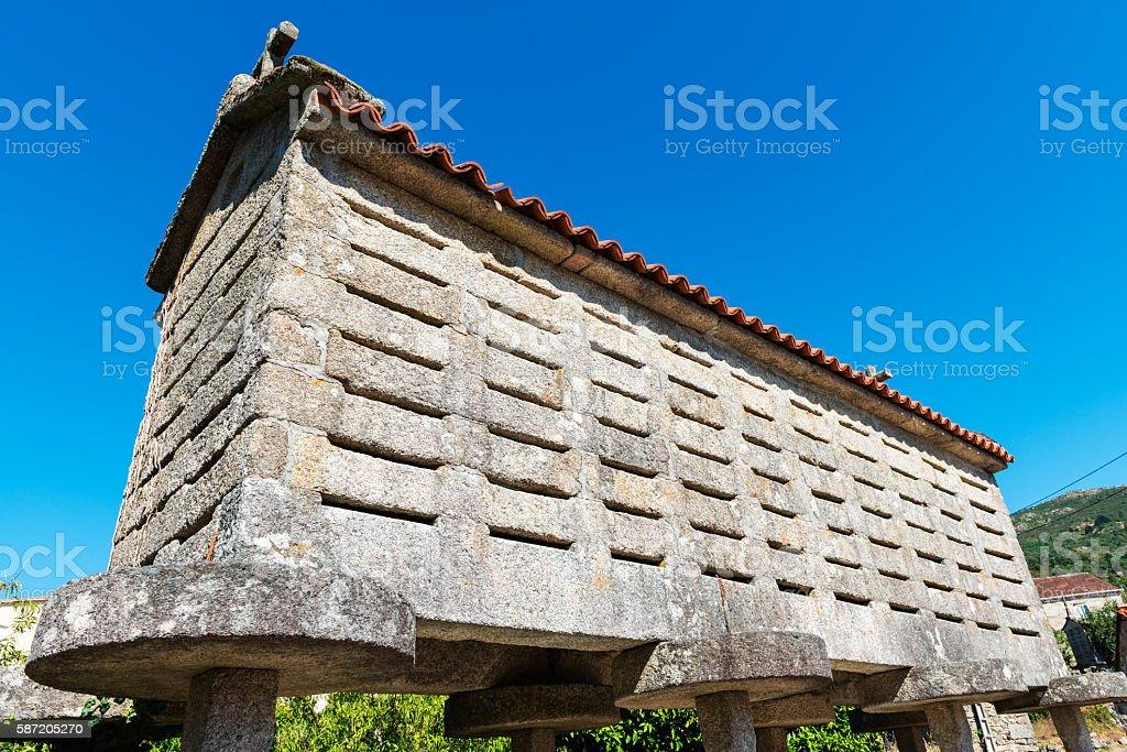 Horreo de Carnota against a clear blue sky stock photo