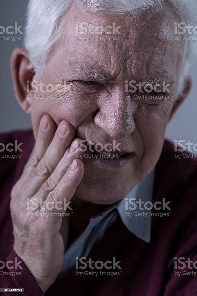 Horrible toothache stock photo