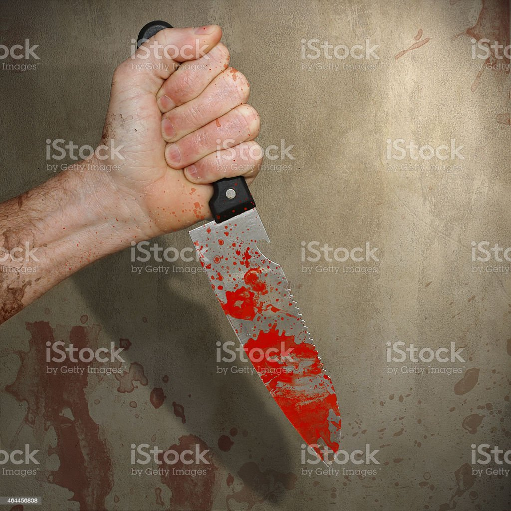 Horror Hand Holding a Bloody Kitchen Knife stock photo