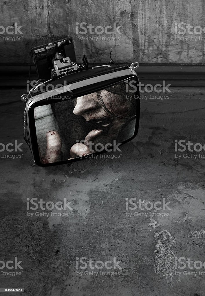 horror movie playing on a tv set with grunge background stock photo