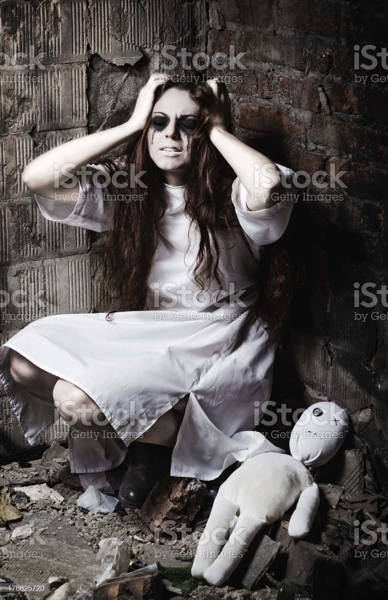 Horror style shot: strange crazy girl and her moppet doll royalty-free stock photo