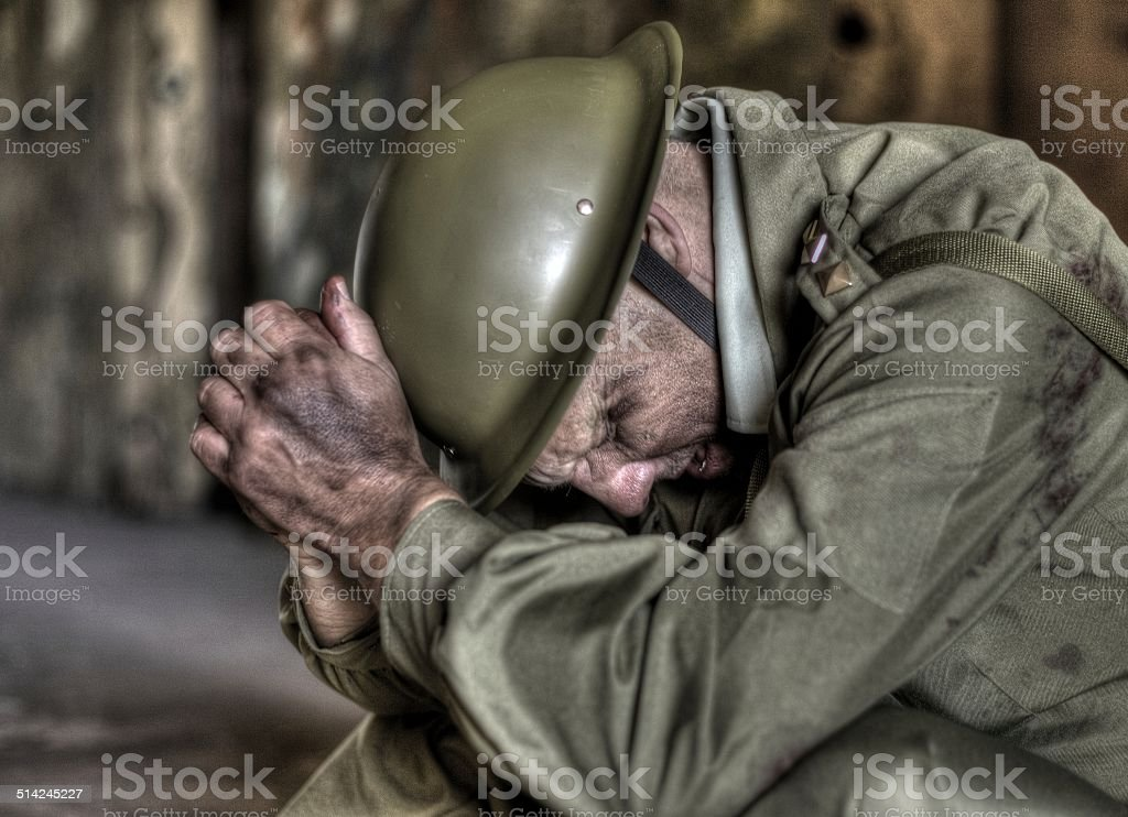 horrors of war, soldier with his head in his hands stock photo
