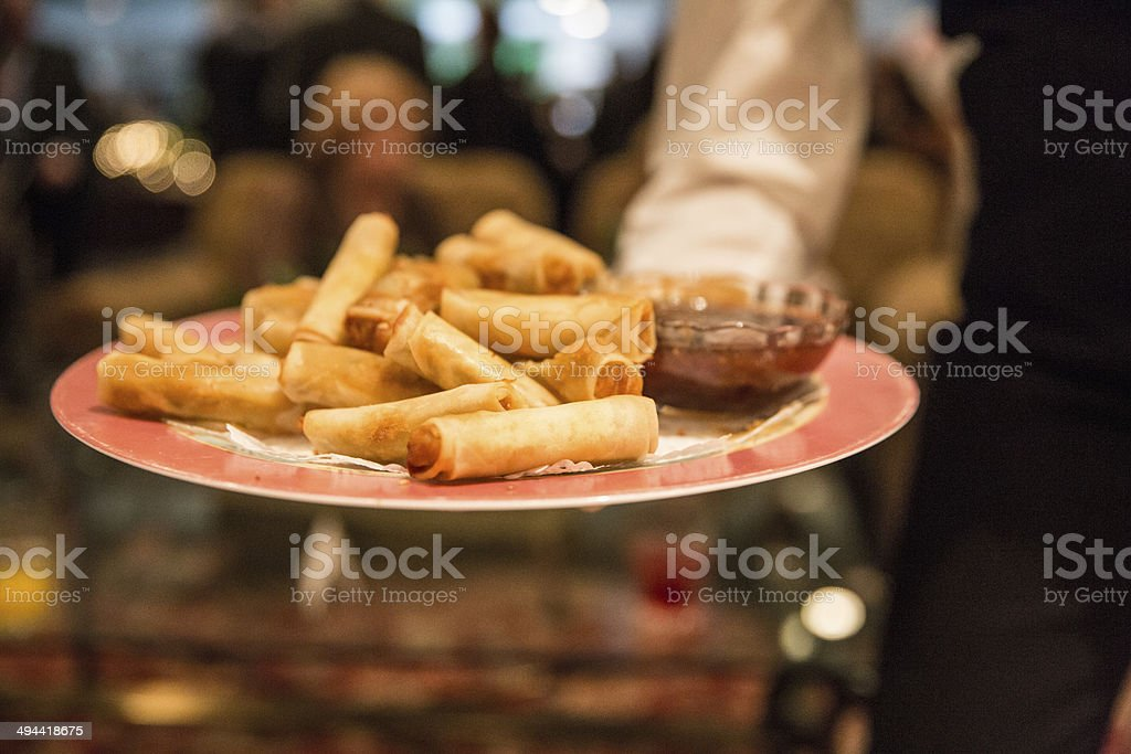 Hors d'oeuvres being passed at a cocktail party royalty-free stock photo