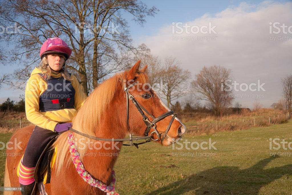Horse and girl out on a ride in the countryside royalty-free stock photo