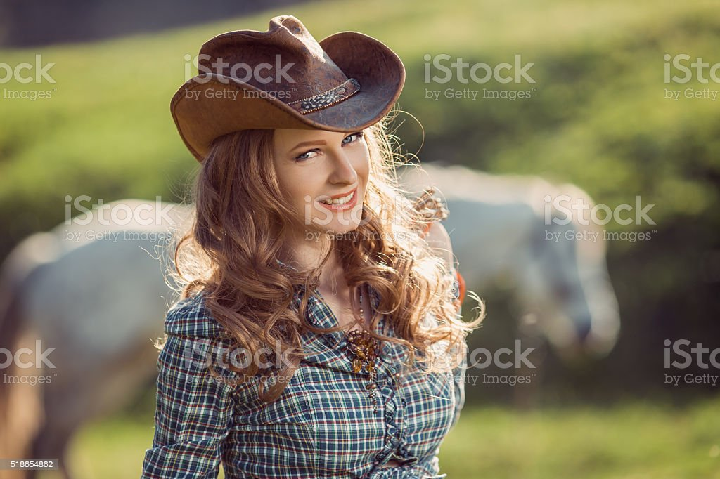 Horse and girl with cowboy hat stock photo