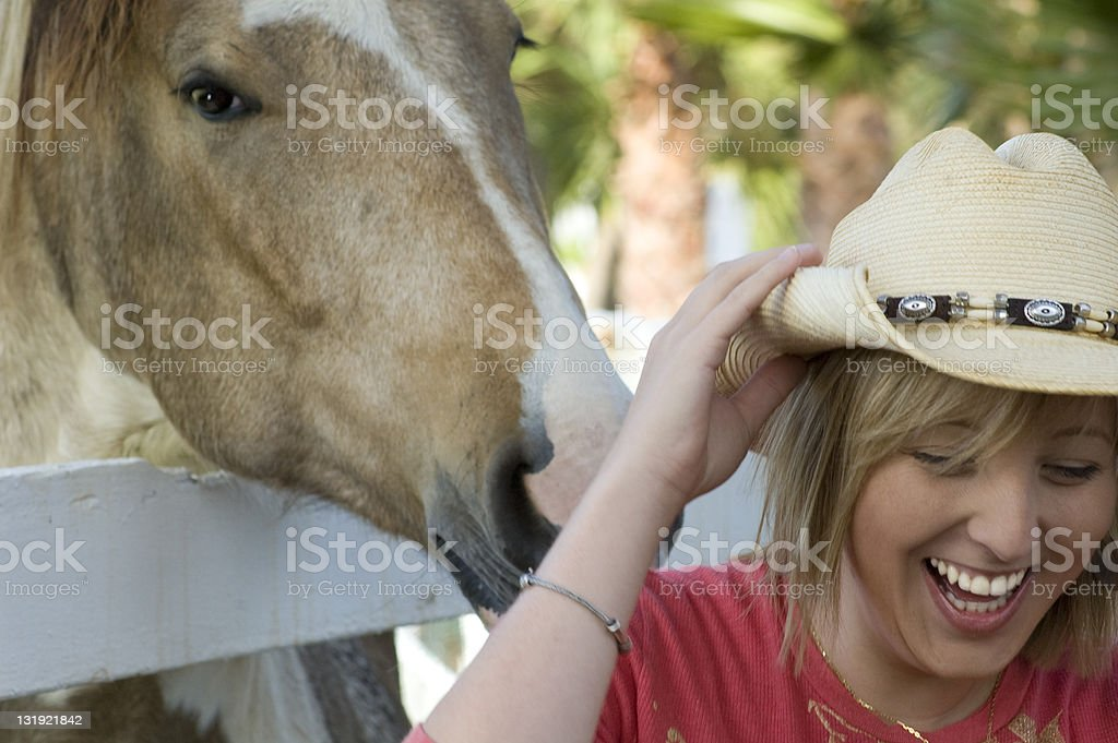 Horse and laughing girl stock photo