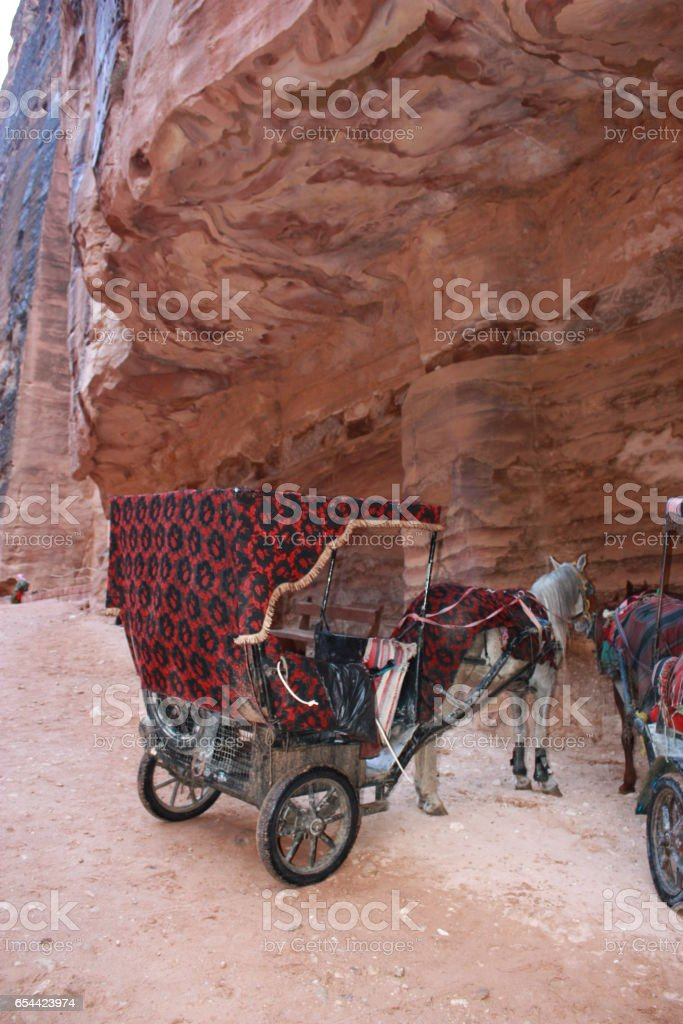 Horse carriage in front of Khazne al-Firaun Treasure house in nabatean city of Petra, Jordan Middle East stock photo