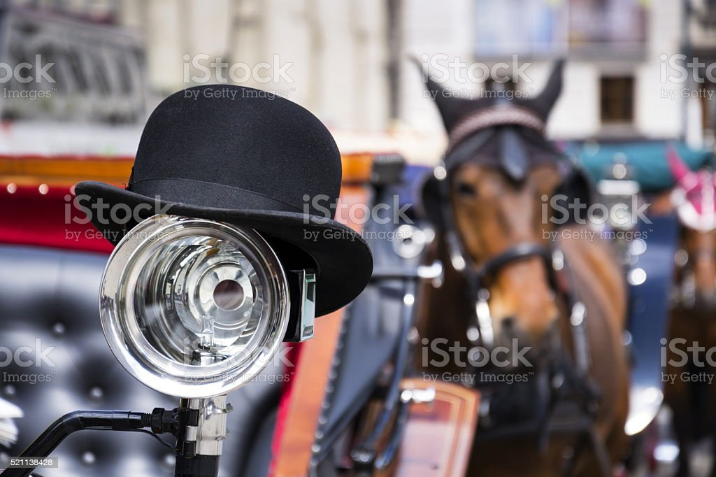 Horse carriage in Vienna, Austria with bowler on light stock photo