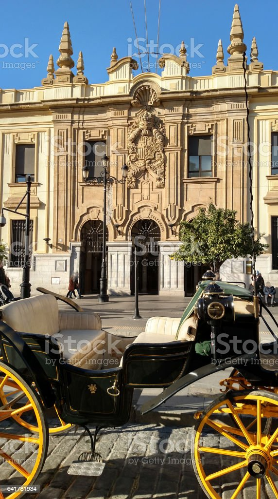 Horse carriage parked curb by historic Post Office Seville Spain stock photo