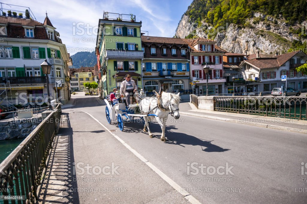 Horse carriage with tourists in Interlaken, Switzerland stock photo