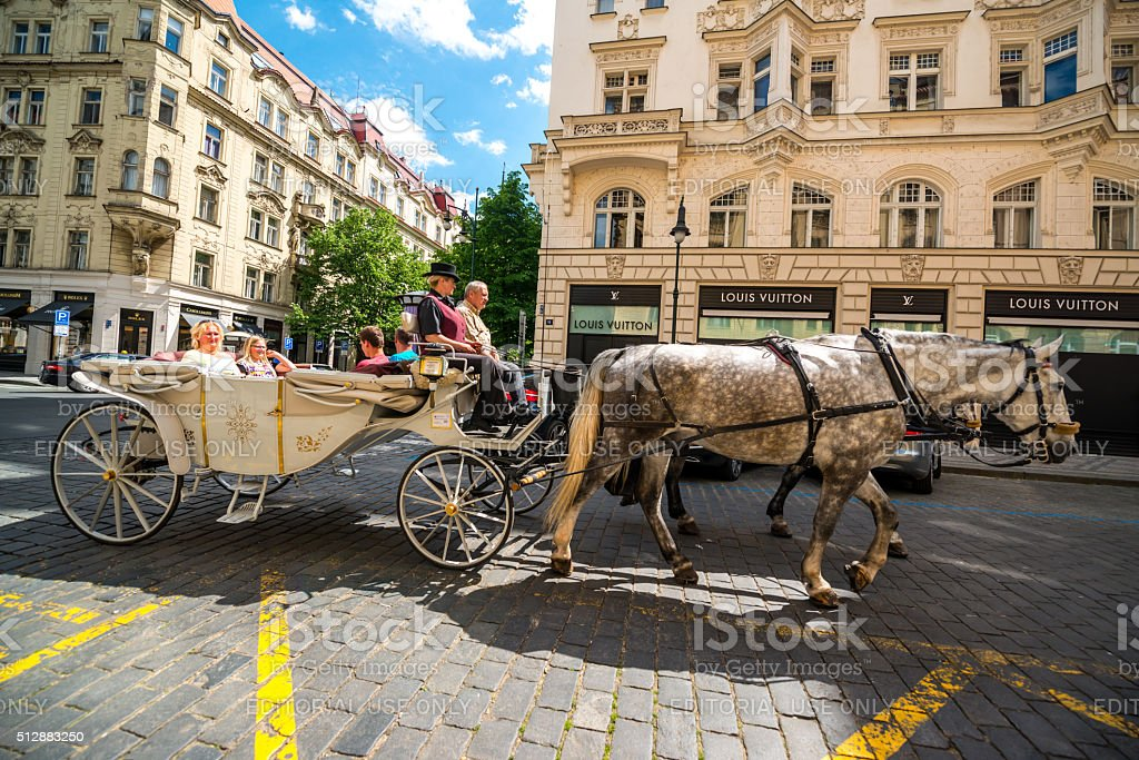 Horse carriage with tourists on Prague street stock photo