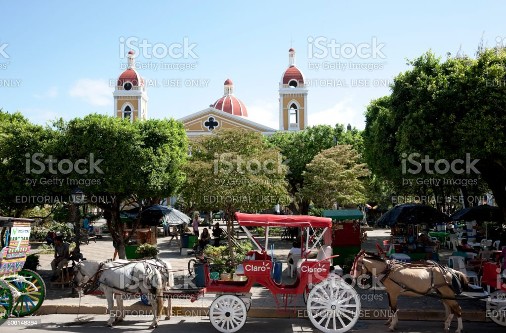 Horse carriages near Central Park in Granada, Nicaragua stock photo