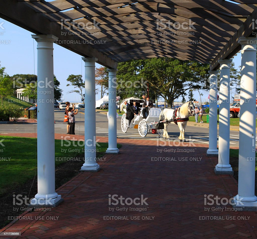 Horse Drawn Carriage in Brewster Gardens, Plymouth, Massachusetts, USA. stock photo