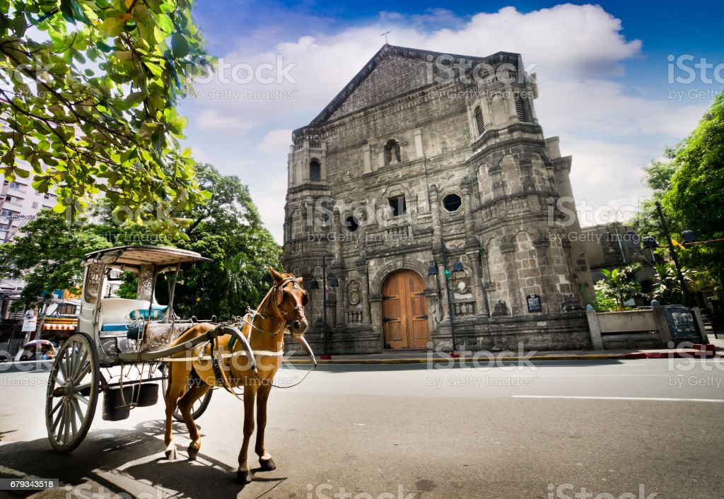 Horse Drawn Carriage parking in front of Malate church , Manila Philippines stock photo