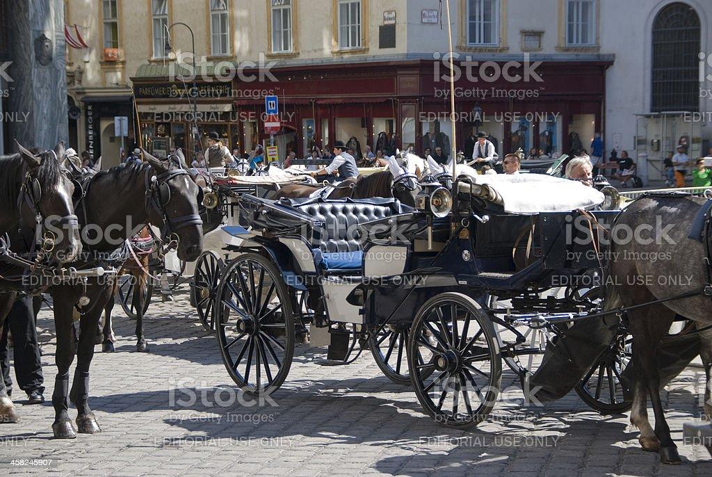 Horse drawn coaches 'Fiaker' in Vienna's City Center, Austria royalty-free stock photo