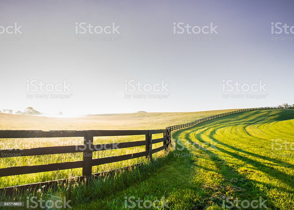 Horse Fence Snakes its Way Over the Hill stock photo